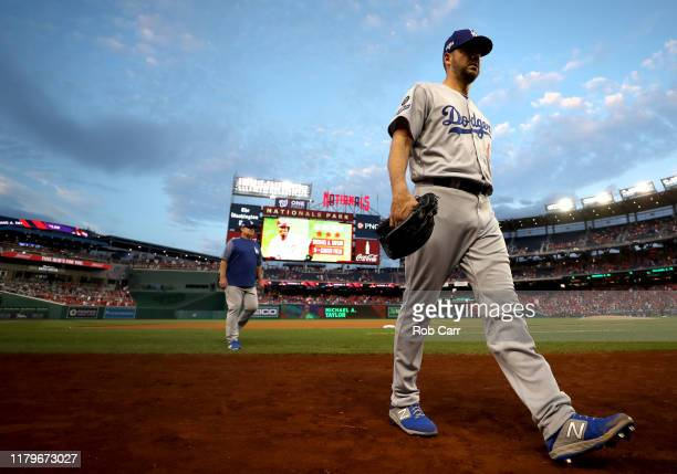 Starting pitcher Rich Hill of the Los Angeles Dodgers walks back to the dug out before the start of game four of the National League Division Series...
