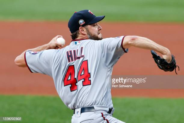 Starting pitcher Rich Hill of the Minnesota Twins pitches against the Cleveland Indians during the first inning at Progressive Field on August 25,...