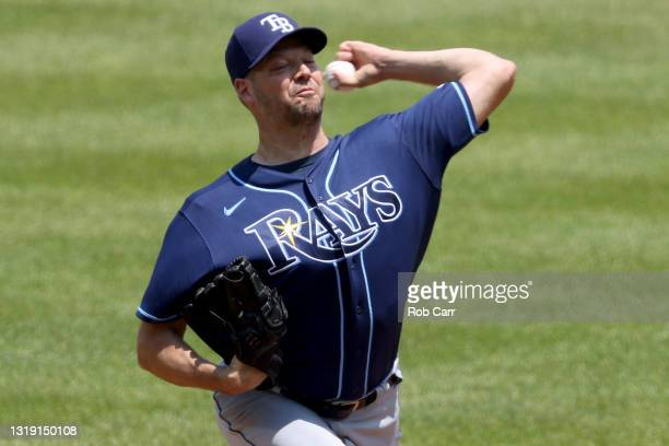 Starting pitcher Rich Hill of the Tampa Bay Rays throws to a Baltimore Orioles batter at Oriole Park at Camden Yards on May 20, 2021 in Baltimore,...