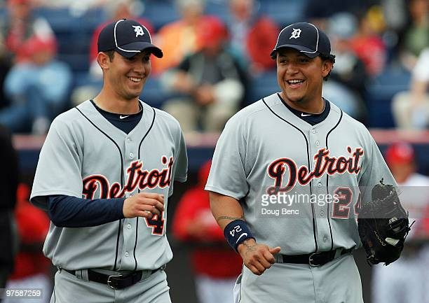 Starting pitcher Rick Porcello of the Detroit Tigers shares a laugh with first baseman Miguel Cabrera after ending the third inning against the...