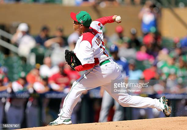 Starting pitcher Rodrigo Lopez of Mexico pitches against Italy during the World Baseball Classic First Round Group D game at Salt River Fields at...