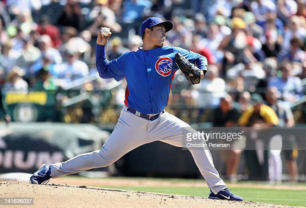 Starting pitcher Rodrigo Lopez of the Chicago Cubs pitches against the Oakland Athletics during the spring training game at Phoenix Municipal Stadium...