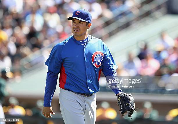 Starting pitcher Rodrigo Lopez of the Chicago Cubs walks off the mound after pitching against the Oakland Athletics during the spring training game...