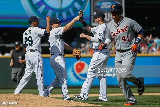 Starting pitcher Roenis Elias of the Seattle Mariners is congratulated by teammates after retiring Victor Martinez for the final out of a complete...