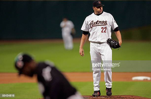 Starting pitcher Roger Clemens of the Houston Astros takes a moment before throwing the first pitch against Luis Castillo of the Florida Marlins on...