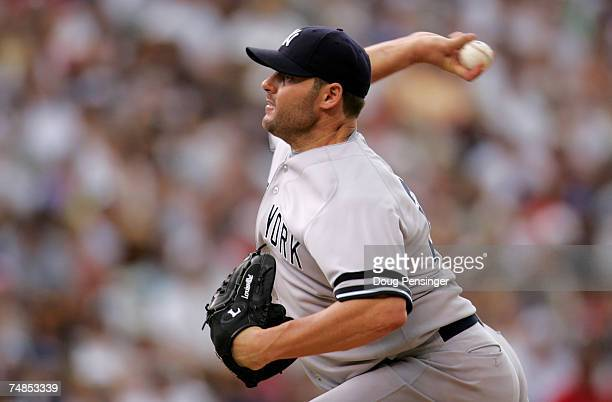 Starting pitcher Roger Clemens of the New York Yankees delivers against the Colorado Rockies and collected the loss as the Rockies defeated the...