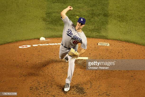 Starting pitcher Ross Stripling of the Los Angeles Dodgers throws a pitch against the Arizona Diamondbacks during the third inning of the MLB game at...