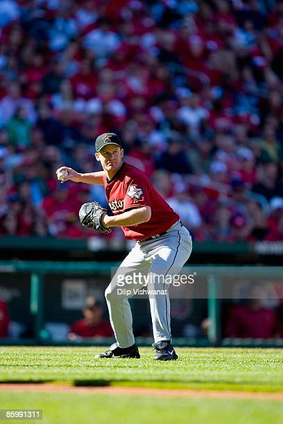 Starting pitcher Roy Oswalt of the Houston Astros throws to first base against the St. Louis Cardinals on April 11, 2009 at Busch Stadium in St....
