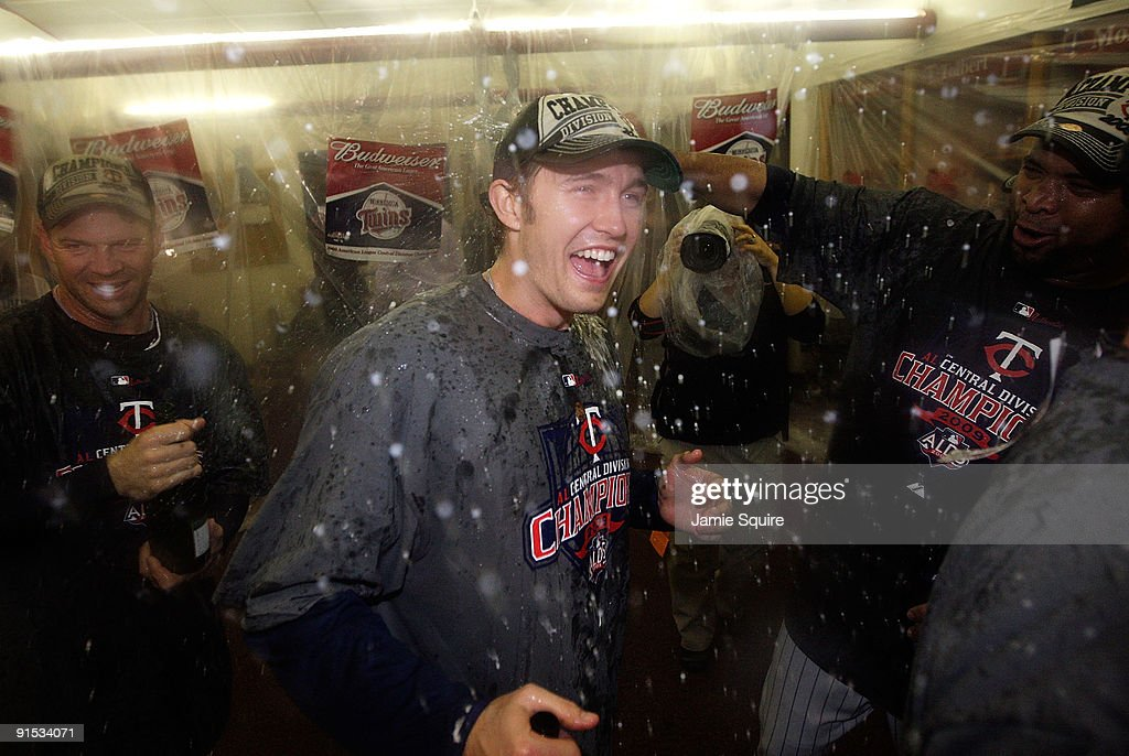 Starting pitcher Scott Baker of the Minnesota Twins is doused with champagne as he celebrates with teammates in the locker room after the Twins defeated the Detroit Tigers to win the American League Tiebreaker game on October 6, 2009 at Hubert H. Humphrey Metrodome in Minneapolis, Minnesota.