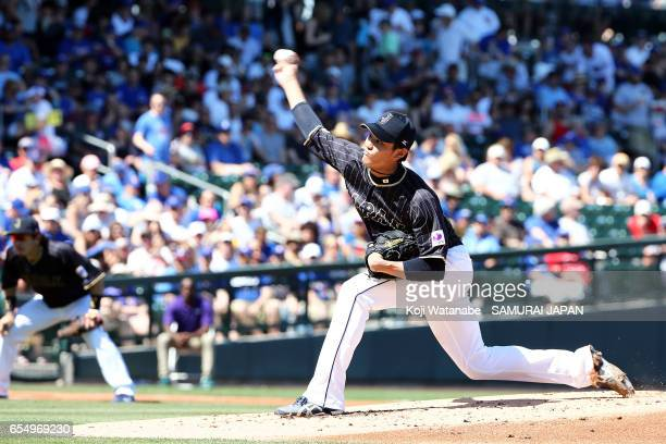 Starting pitcher Shintaro Fujinami in the bottom half of the first inning during the exhibition game between Japan and Chicago Cubs at Sloan Park on...