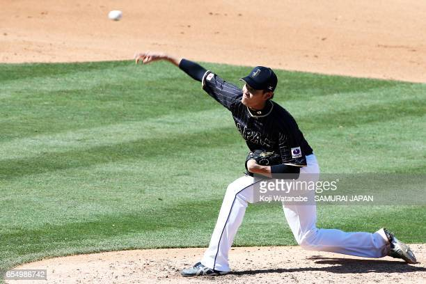 Starting pitcher Shintaro Fujinami in the bottom half of the fourth inning during the exhibition game between Japan and Chicago Cubs at Sloan Park on...