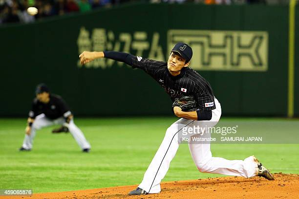 Starting pitcher Shintaro Fujinami of Samurai Japan pitches in the first inning during the game four of Samurai Japan and MLB All Stars at Tokyo Dome...