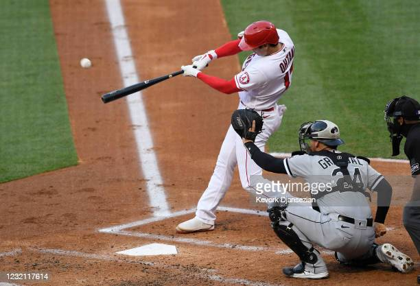 Starting pitcher Shohei Ohtani of the Los Angeles Angels hits a one run home run against pitcher Dylan Cease of the Chicago White Sox during the...