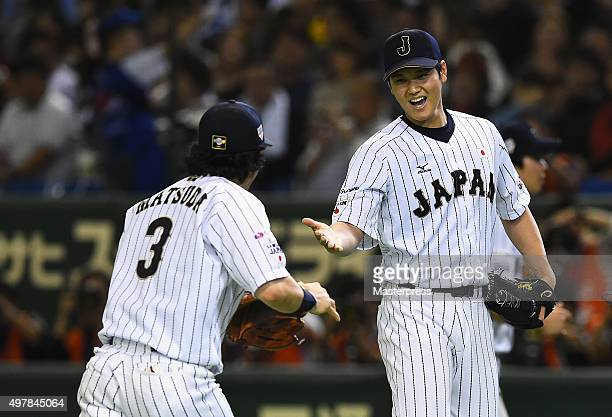 Starting pitcher Shohei Otani of Japan high fives with infielder Nobuhiro Matsuda after the top of sixth inning during the WBSC Premier 12 semi final...