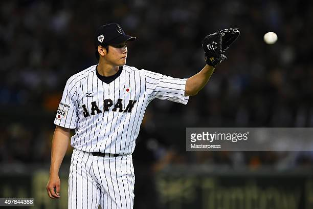 Starting pitcher Shohei Otani of Japan catches in the top of fifth inning during the WBSC Premier 12 semi final match between South Korea and Japan...