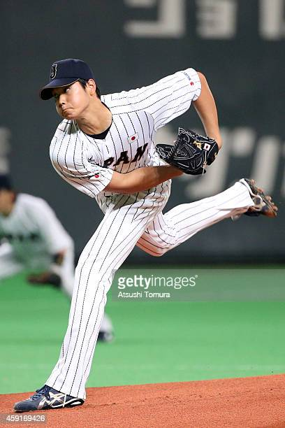 Starting pitcher Shohei Otani of Samurai Japan pitches in the first inning during the game five of Samurai Japan and MLB All Stars at Sapporo Dome on...