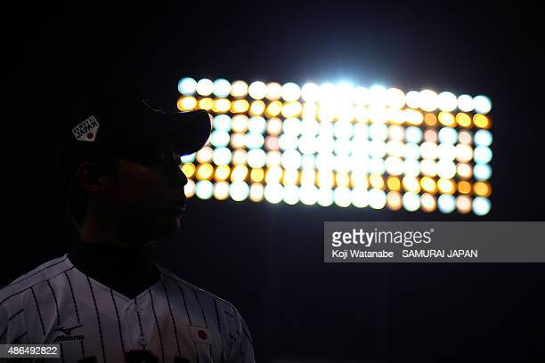 Starting pitcher Shotaro Ueno looks on the game between Australia and Japan in the super round game between Japan v South Korea during the 2015 WBSC...