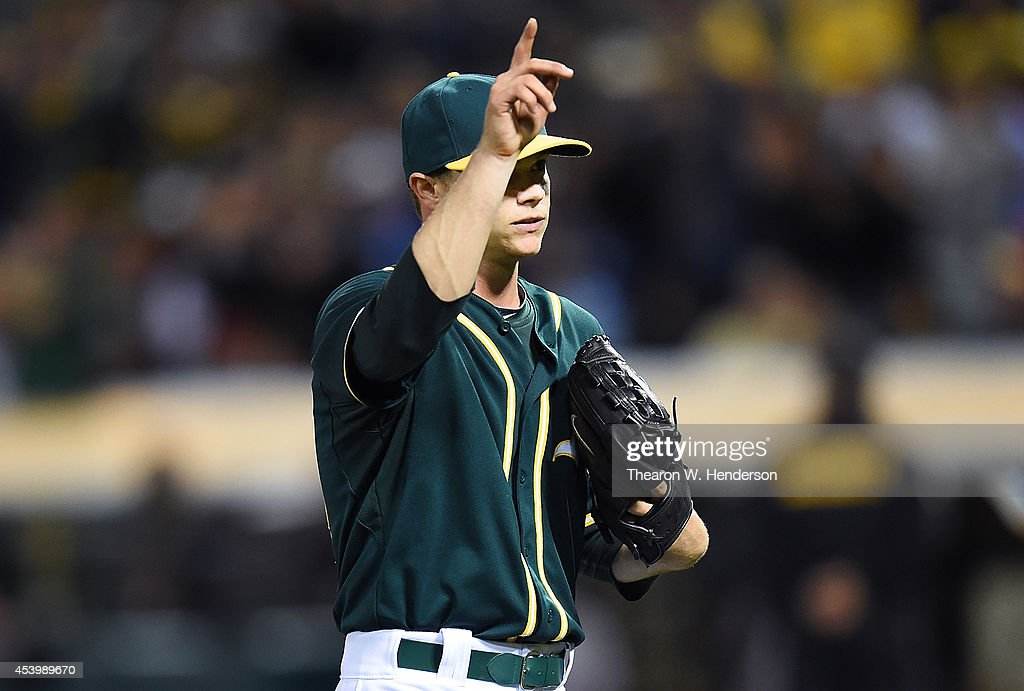 Starting pitcher Sonny Gray #54 of the Oakland Athletics salutes the fans after he was taken out of the game in the top of the ninth inning against the Los Angeles Angels of Anaheim at O.co Coliseum on August 22, 2014 in Oakland, California. The Athletics won the game 5-3.
