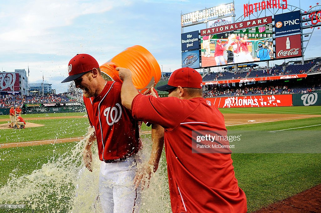 Starting pitcher Stephen Strasburg #37 of the Washington Nationals is doused with Gatorade by teammates Tyler Clippard #36 (in back) and Craig Stammen #35 after the Nationals defeated the Philadelphia Phillies 6-0 during a game at Nationals Park on August 11, 2013 in Washington, DC. Strasburg pitched his first complete game.