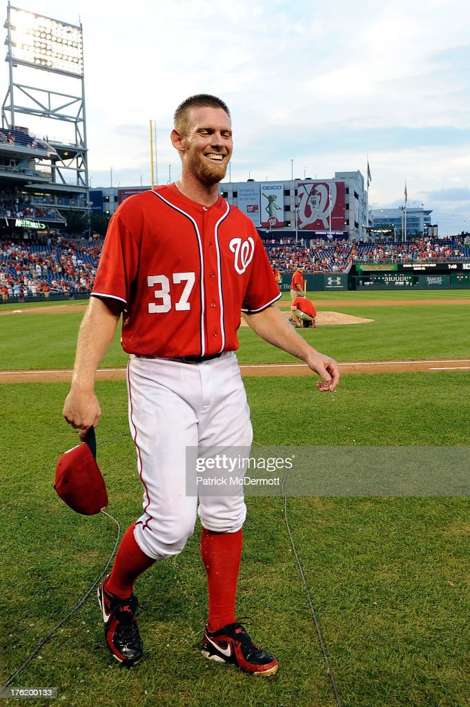 Starting pitcher Stephen Strasburg #37 of the Washington Nationals reacts after being doused with Gatorade by teammates Tyler Clippard #36 and Craig Stammen #35 (not pictured) after the Nationals defeated the Philadelphia Phillies 6-0 during a game at Nationals Park on August 11, 2013 in Washington, DC. Strasburg pitched his first complete game.