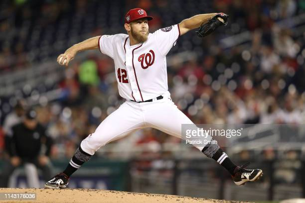 Starting pitcher Stephen Strasburg of the Washington Nationals works the fourth inning against the San Francisco Giants at Nationals Park on April 16...