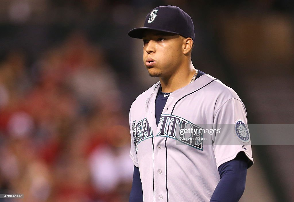 Starting pitcher Taijuan Walker #32 of the Seattle Mariners reacts as he returns to the dugout after getting the final out of the seventh inning to complete his appearance on his way to the win against the Los Angeles Angels of Anaheim at Angel Stadium of Anaheim on June 26, 2015 in Anaheim, California.