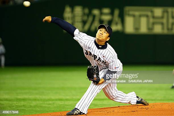 Starting pitcher Takahiro Norimoto of Samurai Japan pitches in the first inning during the game three of Samurai Japan and MLB All Stars at Tokyo...