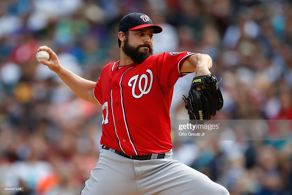 Starting pitcher Tanner Roark #57 of the Washington Nationals pitches in the first inning against the Seattle Mariners at Safeco Field on August 31, 2014 in Seattle, Washington.