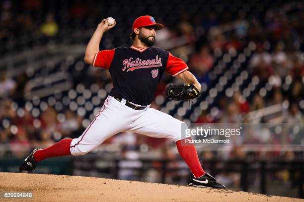 Starting pitcher Tanner Roark of the Washington Nationals throws a pitch to a New York Mets batter in the second inning during Game Two of a...