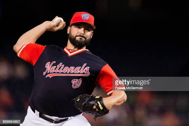 Starting pitcher Tanner Roark of the Washington Nationals throws a pitch to a New York Mets batter in the first inning during Game Two of a...