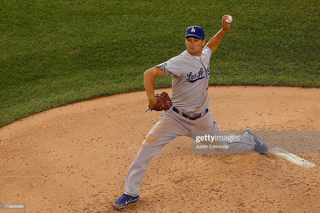 Starting pitcher Ted Lilly #29 of the Los Angeles Dodgers works the fifth inning against the Colorado Rockies at Coors Field on June 11, 2011 in Denver, Colorado.