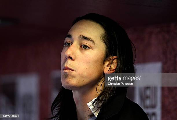 Starting pitcher Tim Lincecum of the San Francisco Giants watches from the dugout during the Opening Day game against the Arizona Diamondbacks at...