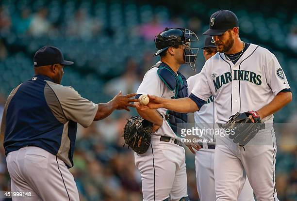 Starting pitcher Tom Wilhelmsen of the Seattle Mariners is removed from the game by manager Lloyd McClendon in the third inning against the Minnesota...