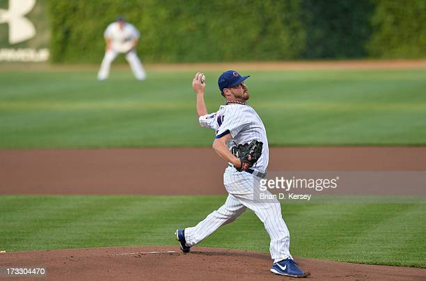 Starting pitcher Travis Wood of the Chicago Cubs delivers during the first inning against the Los Angeles Angels of Anaheim at Wrigley Field on July...