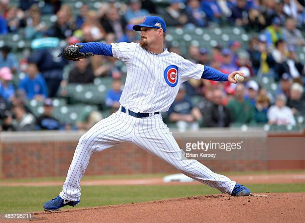 Starting pitcher Travis Wood of the Chicago Cubs delivers during the first inning against the Pittsburgh Pirates at Wrigley Field on April 10 2014 in...