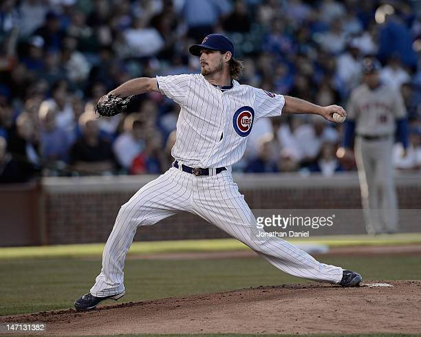 Starting pitcher Travis Wood of the Chicago Cubs delivers the ball against the New York Mets at Wrigley Field on June 25 2012 in Chicago Illinois