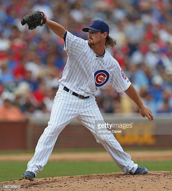 Starting pitcher Travis Wood of the Chicago Cubs delivers the ball against the St Louis Cardinals at Wrigley Field on July 27 2012 in Chicago...