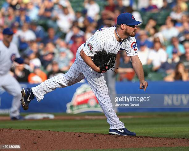 Starting pitcher Travis Wood of the Chicago Cubs delivers the ball against the New York Mets at Wrigley Field on June 5 2014 in Chicago Illinois