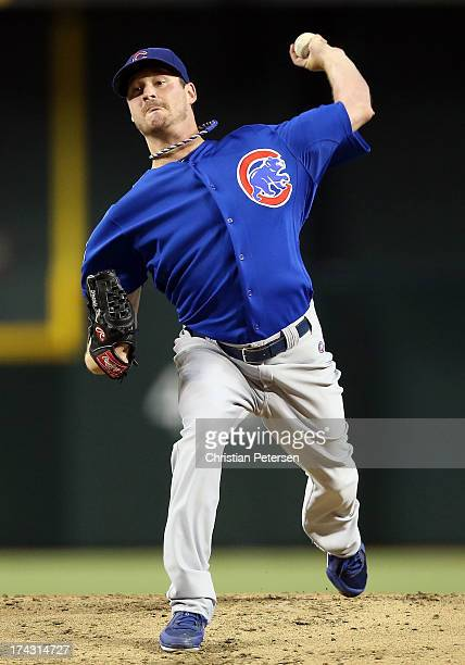 Starting pitcher Travis Wood of the Chicago Cubs pitches against the Arizona Diamondbacks during the MLB game at Chase Field on July 23 2013 in...