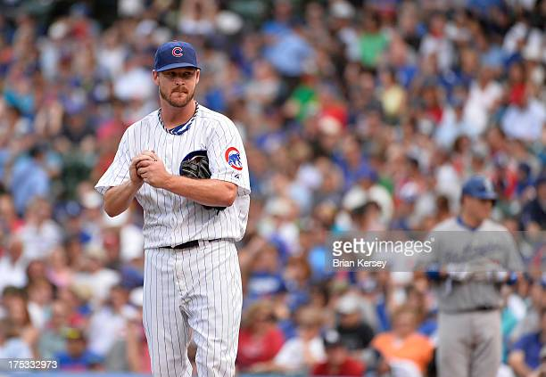 Starting pitcher Travis Wood of the Chicago Cubs stands on the mound during the third inning against the Los Angeles Dodgers at Wrigley Field on...