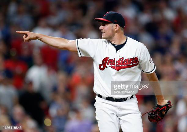 Starting pitcher Trevor Bauer of the Cleveland Indians points to home plate after a pitch against the Detroit Tigers during the seventh inning at...