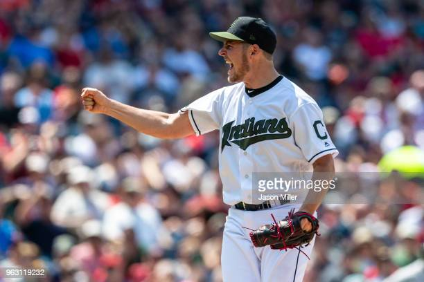 Starting pitcher Trevor Bauer of the Cleveland Indians reacts after striking out Yuli Gurriel of the Houston Astros to end the top of the sixth...