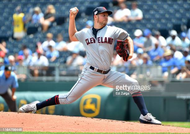 Starting pitcher Trevor Bauer of the Cleveland Indians throws against the Kansas City Royals in the first inning at Kauffman Stadium on July 28 2019...