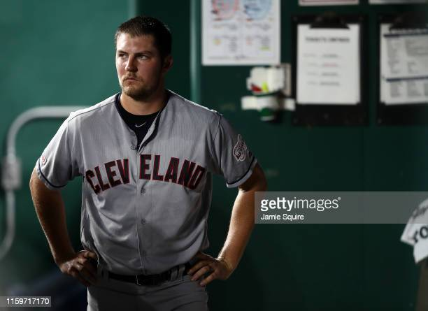 Starting pitcher Trevor Bauer of the Cleveland Indians watches from the dugout after leaving the game during the 7th inning of the game against the...