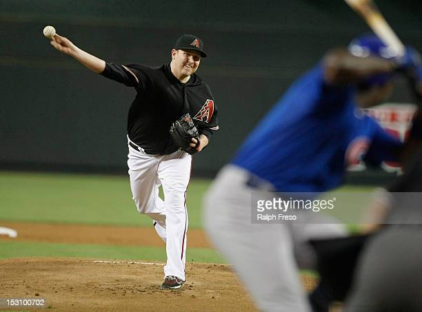 Starting pitcher Trevor Cahill of the Arizona Diamondbacks delivers a pitch to Alfonso Soriano of the Chicago Cubs during the first inning of a MLB...