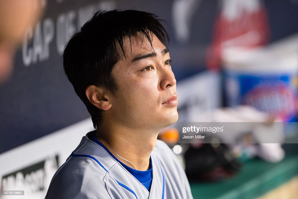 Starting pitcher Tsuyoshi Wada #18 of the Chicago Cubs rests in the dugout after leaving the game in the seventh inning against the Cleveland Indians at Progressive Field on June 17, 2015 in Cleveland, Ohio.