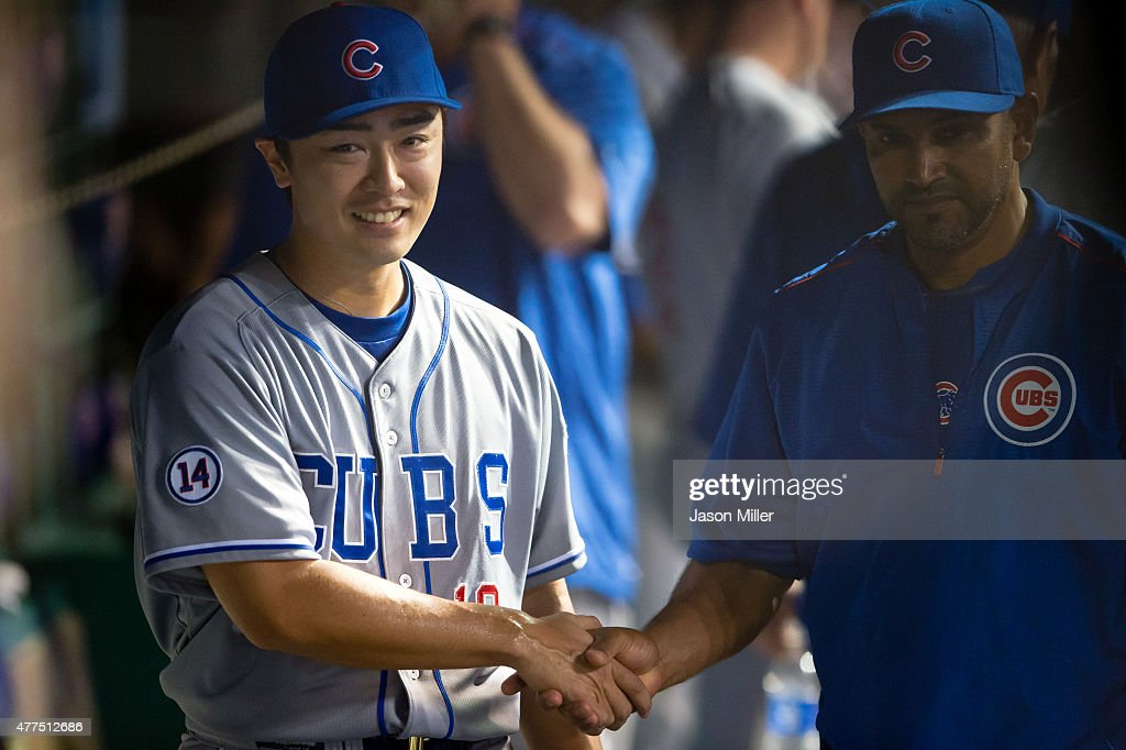 Starting pitcher Tsuyoshi Wada #18 of the Chicago Cubs shakes hands with a teammate after leaving the game after the seventh inning against the Cleveland Indians at Progressive Field on June 17, 2015 in Cleveland, Ohio.