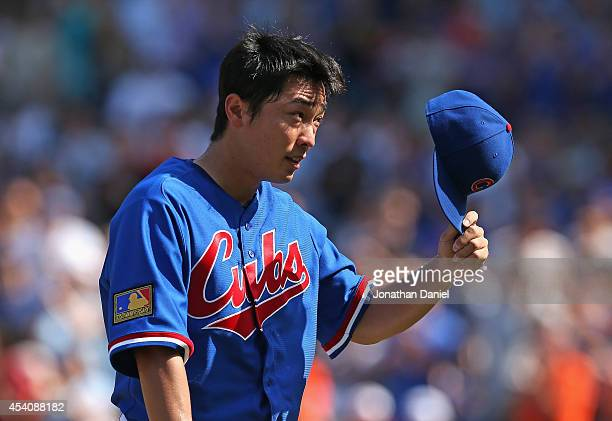 Starting pitcher Tsuyoshi Wada of the Chicago Cubs tips his hat to the crowd after being taken out of a game against the Baltimore Orioles in the 7th...
