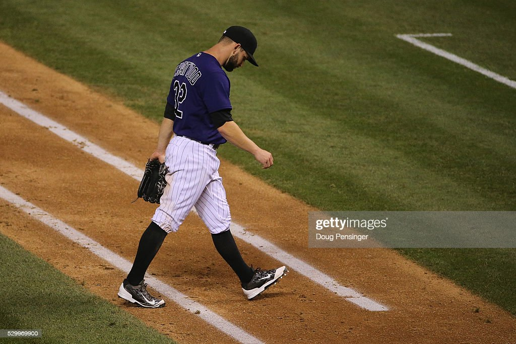 Starting pitcher Tyler Chatwood #32 of the Colorado Rockies heads for the dugout against the Arizona Diamondbacks in the fifth inning at Coors Field on May 09, 2016 in Denver, Colorado. The Diamondbacks defeated the Rockies 10-5.