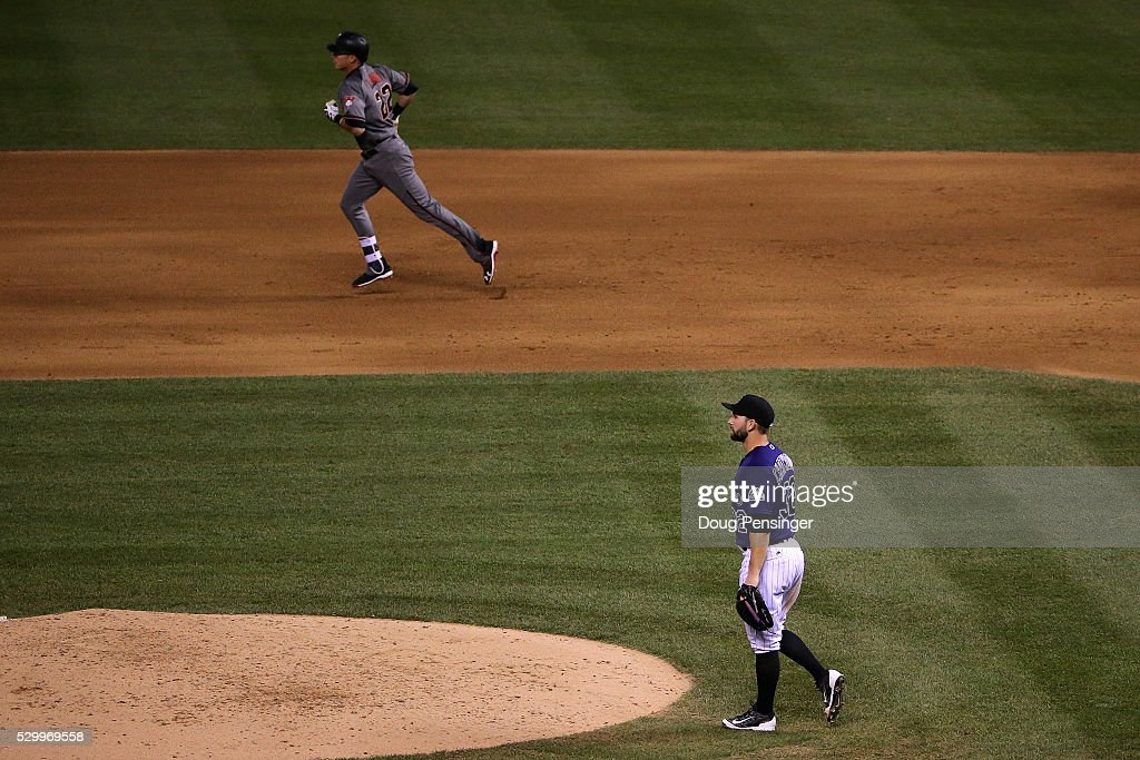 Starting pitcher Tyler Chatwood #32 of the Colorado Rockies returns to the mound as Jake Lamb #22 of the Arizona Diamondbacks rounds the bases on his three run home run to take a 5-4 lead in the fifth inning at Coors Field on May 09, 2016 in Denver, Colorado.